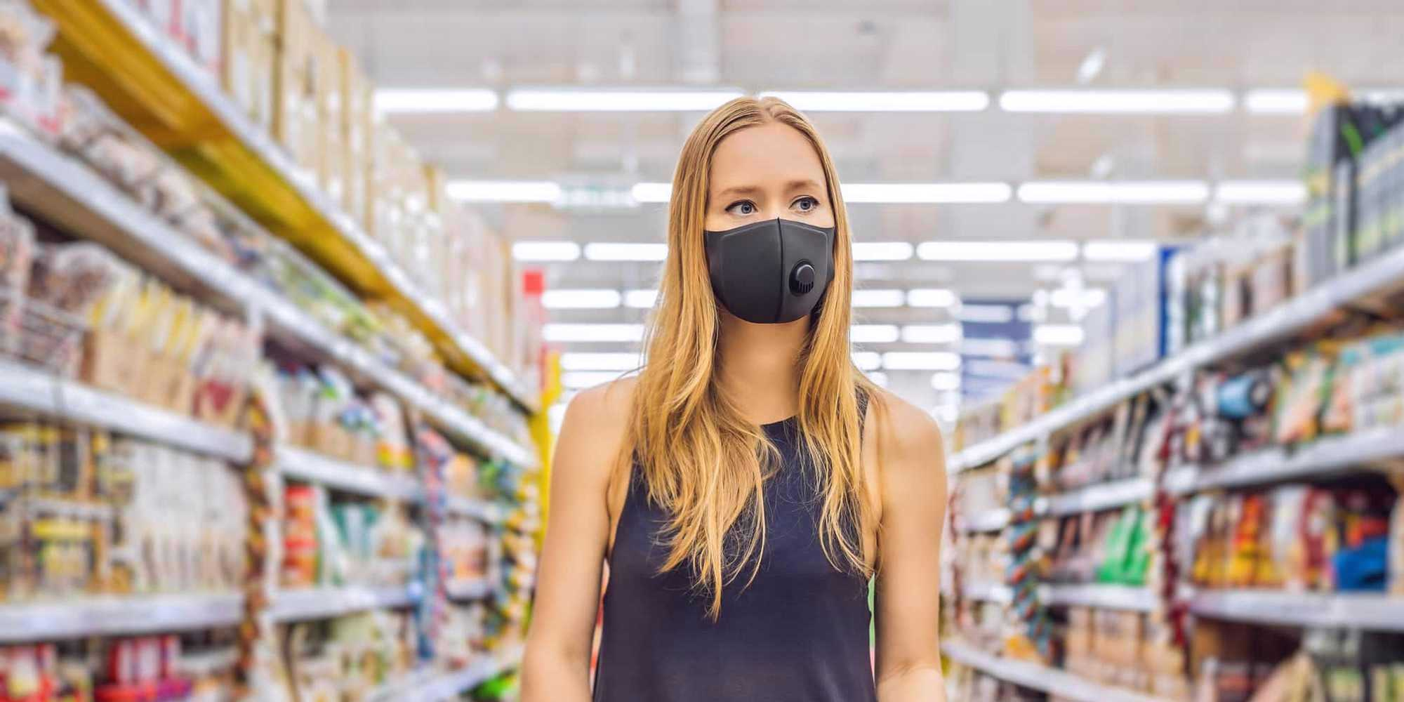 woman with mask in aisle